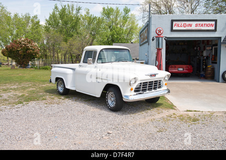 A white, classic 1955 Chevrolet V8 pickup sitting in front of a private memorabilia museum on Route 66 outside of - Stock Photo