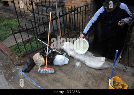 BROOKLYN, NY - OCTOBER 29: Super pumping water out of building basement in the Sheepsheadbay neighborhood - Stock Photo
