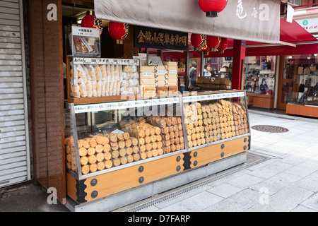 Shop with traditional Japanese sweets in Asakusa, in Nakamise Dori near the temple of Sensoji, Tokyo, Japan - Stock Photo