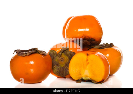 fresh persimmon fruit on a white background - Stock Photo