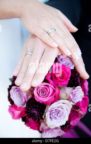 wedding rings and bridal flowers - Stock Photo