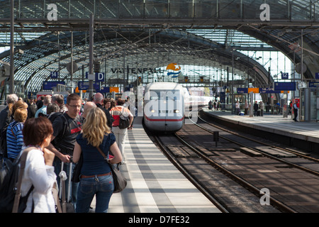 Arrival of an intercity train on the central station of Berlin 'Berlin Hauptbahnhof' - Stock Photo