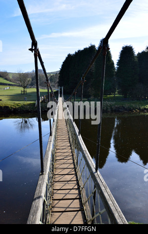 Reflections from the Suspension Bridge over the River Wharfe near Hebden on the Dales Way Long Distance Footpath - Stock Photo