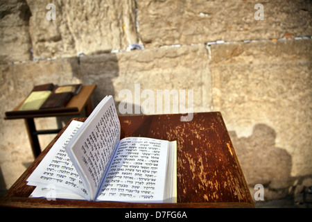 The biblical Book Psalms opened on one pages morning prayer resting on pedistal . There's also shadow Jewish orthodox - Stock Photo