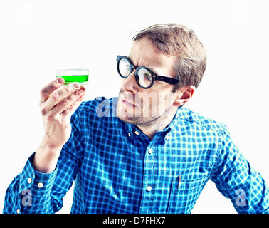 isolated crazy-style scientific with beaker, holding in his hand - Stock Photo
