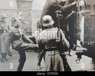 Nazis deporting Polish Jews to death camp from Krakow ghetto at Zgody Sqare in 1942 - Stock Photo