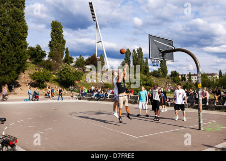 Berlin Germany - June 10th 2012: Early Summer Sunday afternoon at Mauerpark. group people are playing basketball - Stock Photo