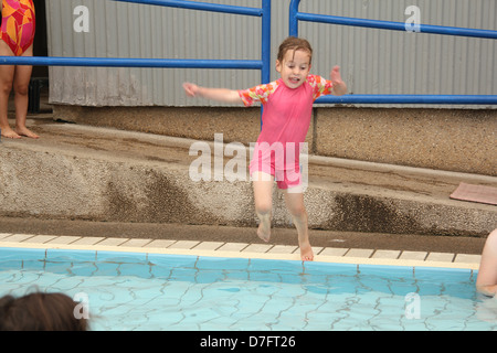 Child jumps into water during Hydrotherapy (hydropathy) treatment - Stock Photo