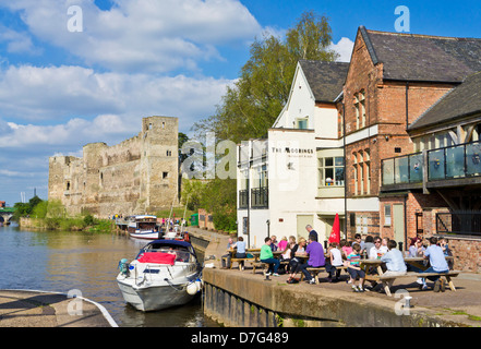 Newark Castle with People sat in front of a pub by the River Trent Newark-on-trent Nottinghamshire England UK GB - Stock Photo