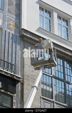 Aerial platform with worker, Vienna - Stock Photo