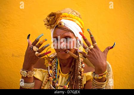 Senora Habana, A priestess of the afro-cuban Santeria with colourful long nails and cigar, Havana, Cuba, Caribbean - Stock Photo