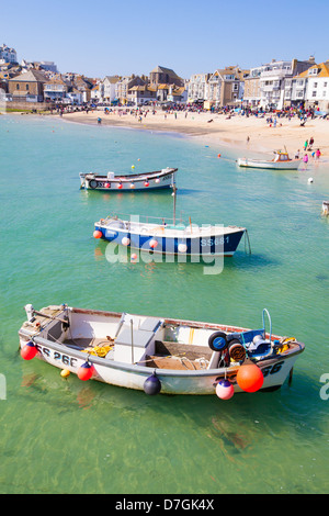 Boats floating in St Ives harbour on a summer day - Stock Photo