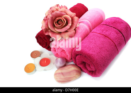 Towels, candles, soaps and flower isolated on white background. - Stock Photo