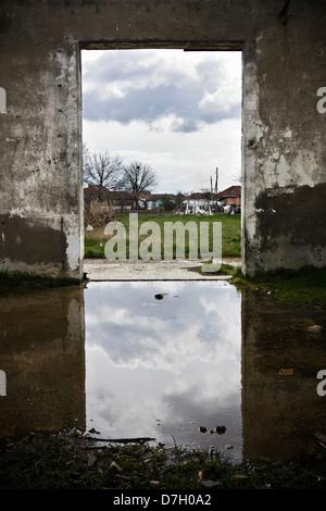 Serbian minority village and ruined building in Kosovo, near Pristina - Stock Photo