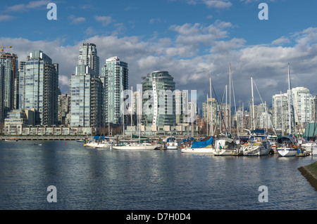 Marina in false creek and the skyline of the Vancouver Condos on sunny day.Vancouver,British Columbia - Stock Photo