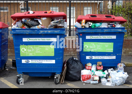 Recycling containers in Tesco supermarket car park - Stock Photo