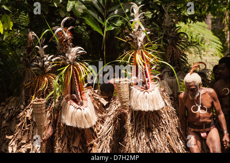 The Rom Dancers make their entrance on the last day of Ambrym's annual Back to My Roots festival of traditional - Stock Photo