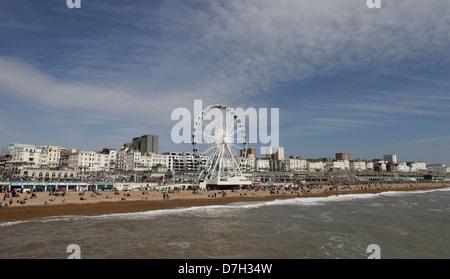 BRIGHTON BEACH, SUSSEX, ENGLAND , UK. the Brighton Wheel, a giant ferris wheel built on Brighton's seafront on Madeira - Stock Photo