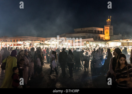 Morocco, Marrakesh - the Night Market and food stalls in Jamaa el Fna after dark. - Stock Photo