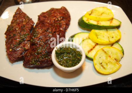 Miami Florida Coral Way 1401 Argentinean Bistro restaurant plate dinner flank steak churrasco vegetables Chimmichurri - Stock Photo