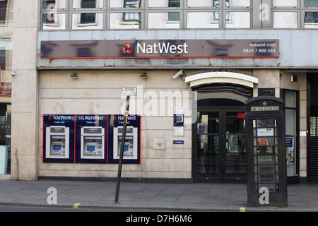 Front entrance to the Natwest Bank and Cash Machines - Stock Photo