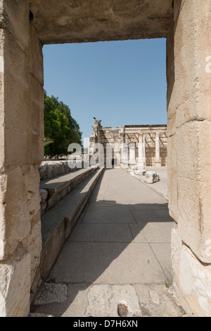 The Synagogue in Capernaum viewed from the entrance and framed by the doorway - Stock Photo