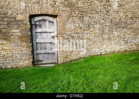 Old Wood Door In A Stone Wall Of An Ancient Building Of An