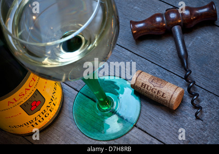 Gewurztraminer white wine bottle glass and cork in wine tasting situation of renowned producer 'Hugel'  Riquewihr - Stock Photo