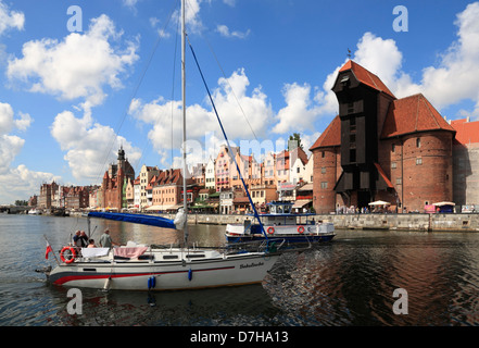 Gdansk, sailing boat on Motlawa in front of Crane Gate, Poland - Stock Photo