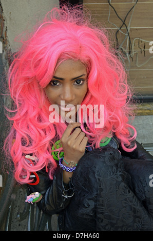 Portrait of a beautiful woman in a pink wig in Greenwich Village, New York City - Stock Photo