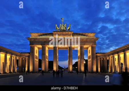 The Brandenburg Gate in Berlin at night - Stock Photo