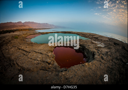 fisheye view of Water pools in sink holes on the shore of the Dead Sea, Israel - Stock Photo