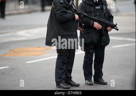 London, UK. 8th May 2013. Armed police line the route in Parliament Square, Westminster, prior to the state opening - Stock Photo