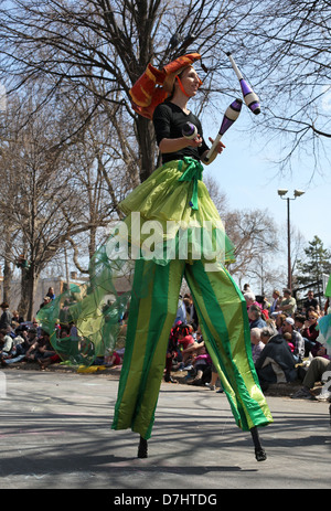 A juggler on stilts at the May Day parade in Minneapolis, Minnesota. - Stock Photo