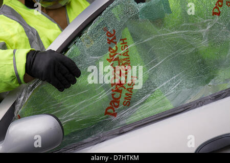 Formby, Merseyside, UK  8th May, 2013. Packexe Smash Film on broken window, used in a Rescue Demonstration during - Stock Photo
