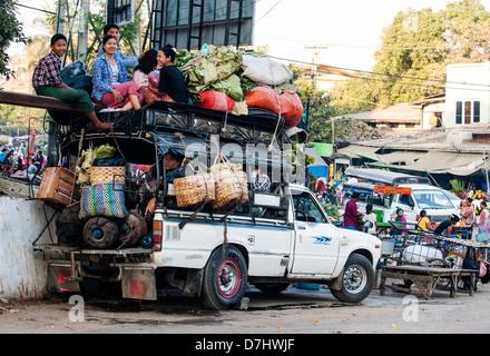 Overcrowded pickup truck – most popular form of transport around the country, Amarapura, Mandalay, Burma (Myanmar) - Stock Photo