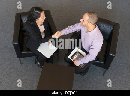 Man and woman at meeting in office seen from above - Stock Photo