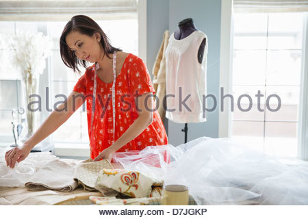 Female seamstress working in home studio - Stock Photo