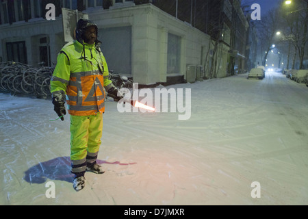 traffic controller in snowy amsterdam - Stock Photo