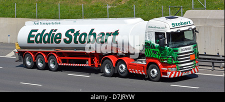 Petrol tanker articulated hgv Scania lorry operated by Eddie Stobart on M25 London orbital motorway - Stock Photo