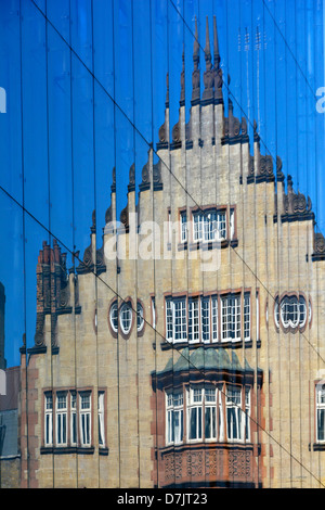 Reflection of old building in modern glass cladding to new office block West End London England UK - Stock Photo