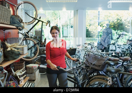Business owner in bicycle store - Stock Photo