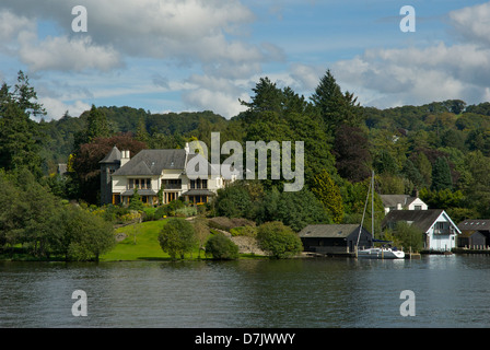Grand house and gardens overlooking Lake Windermere, Lake District National Park, Cumbria, England UK - Stock Photo