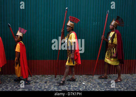 Men dressed as Roman legionaries participate in a a procession during Semana Santa in La Antigua Guatemala, March - Stock Photo