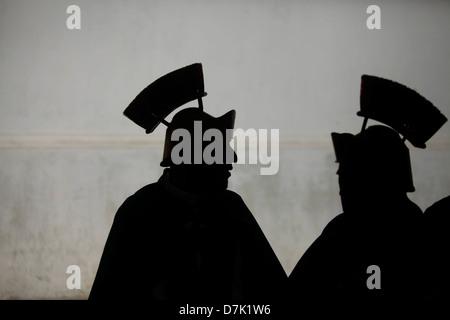 Silhouettes of men dressed as Roman legionaries participate in a a procession during Semana Santa in La Antigua - Stock Photo
