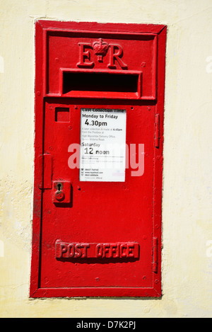 Antique red post box on High Street, West Wycombe, Buckinghamshire, England, United Kingdom - Stock Photo