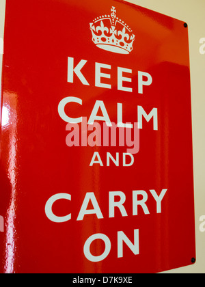 World War two propaganda poster Keep Calm and Carry On in red and white nailed to wall Derbyshire England - Stock Photo