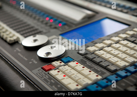 Close up of electronic mixing console/desk used for lighting show England - Stock Photo
