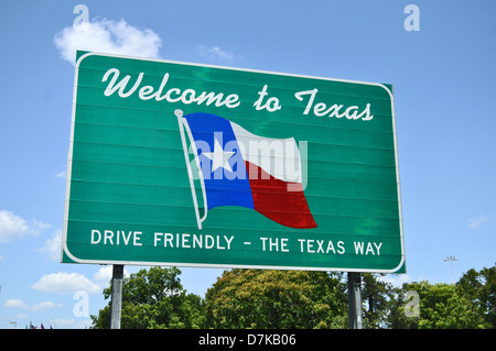 A Welcome to Texas road sign set against a light blue background showing the state flag - Stock Photo
