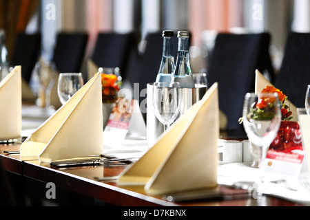 Germany, Baden Wuerttemberg, Heidelberg, Table laid with wine bottles and glasses - Stock Photo